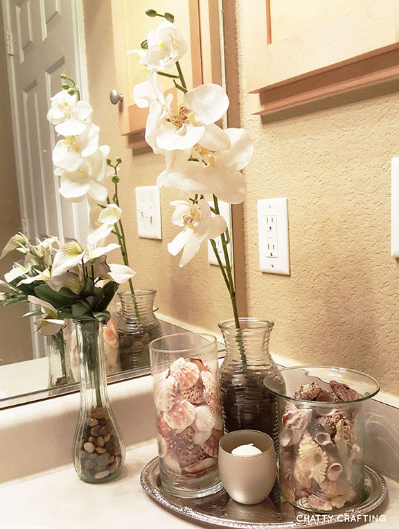 Affordable dollar store coastal bathroom idea chatty for Cheap bathroom decor